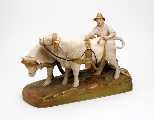 A Royal Dux figure of a cattle farmer  Circa 1900