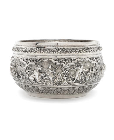 A Burmese silver rice bowl peacock engraved to underside