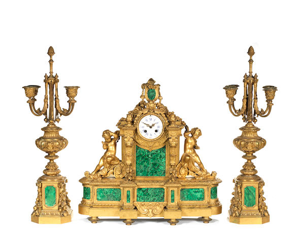 A 19th century gilt bronze and malachite garniture (clock and pair of candelabra