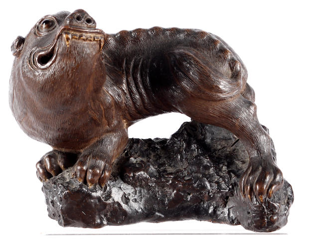 A Chinese stoneware model of a mythical beast