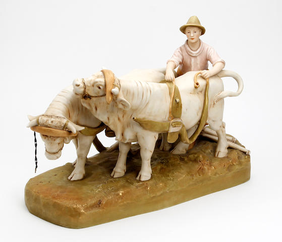 A Royal Dux figure group of oxen and drover Circa 1900