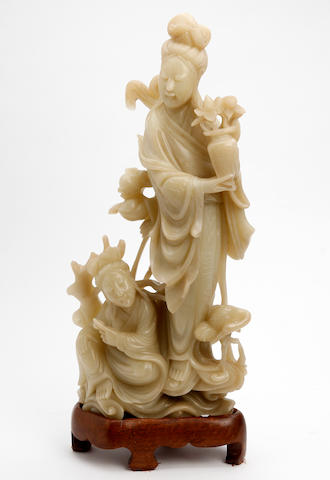 A large soapstone carving of Guanyin and Princess Miaoshen  19th Century