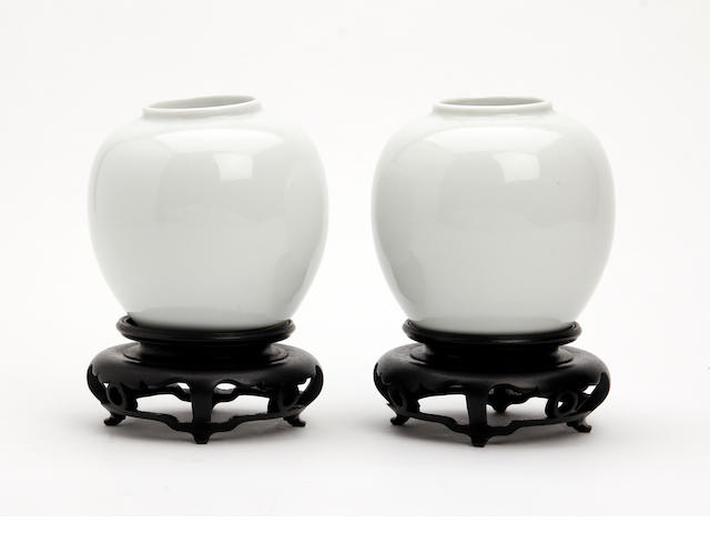 A pair of Chinese white glazed vases 18th/19th Century
