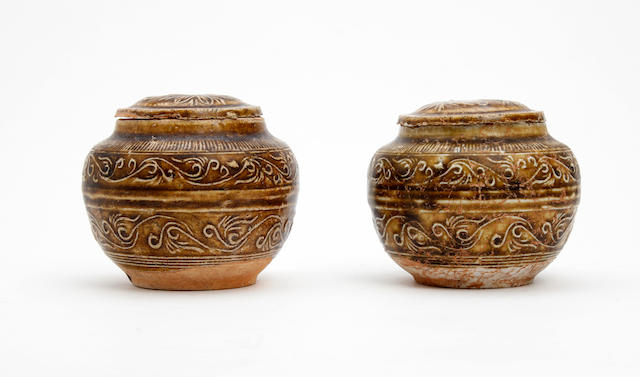 Pair brown glazed jars and covers