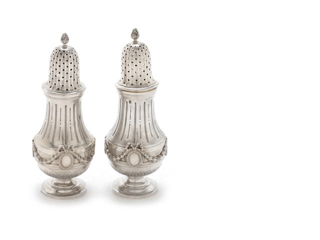 A pair of French late 19th/early 20th century silver casters by G. Boin, with retail mark for Bointaburet á Paris, Paris, stamped with Minerva head  (2)
