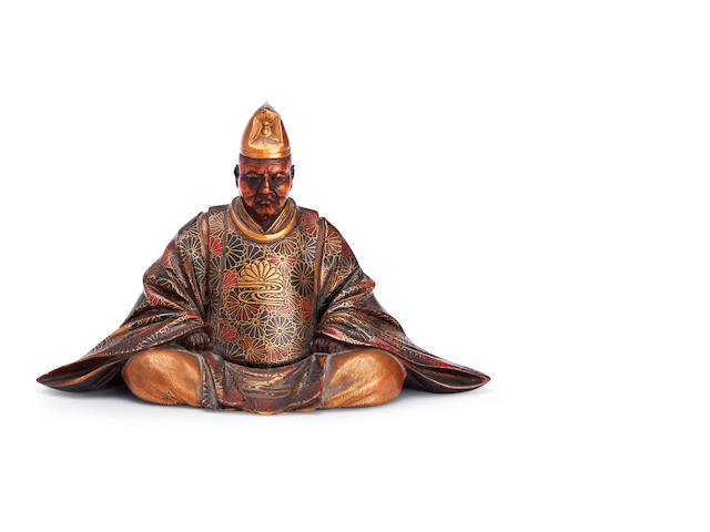 A lacquered wood figure of a nobleman Meiji/Taisho