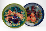 A collection of four Moorcroft chargers