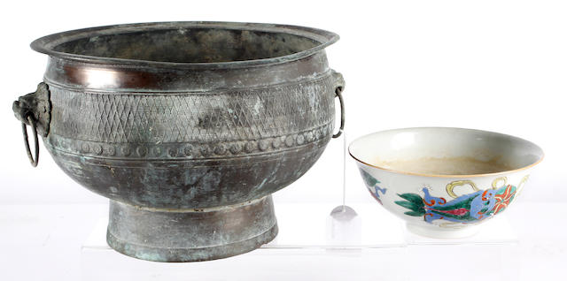 A Chinese metal ware footed bowl and a Chinese porcelain bowl
