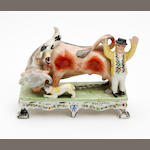 A Staffordshire bull baiting figure group Mid 19th century