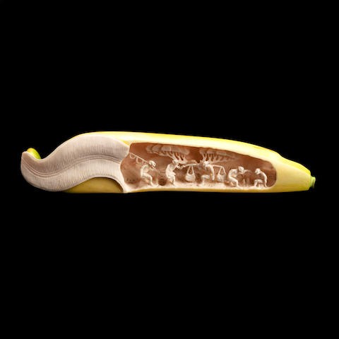 A carved ivory okimono
