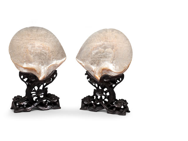 A pair of mother of pearl carved shells on wood stands 19th century