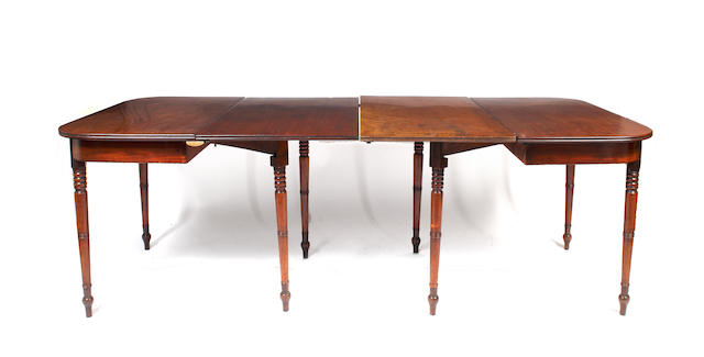 An early 19th Century mahogany double 'D' end dining table,with reeded edge top on a plan frieze and turned tapered legs and two leaves, 216 maximum x 107cm wide, together with a set of eight mahogany shield back dining chairs, with stuff over seats, on square tapered legs and spade feet, to include a pair of elbow chairs.