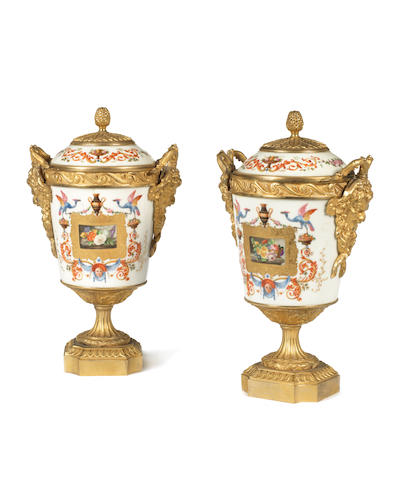 A pair of 20th century gilt-bronze mounted porcelain vases and covers