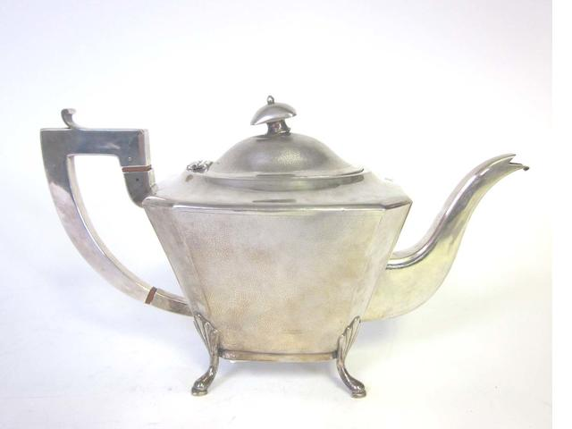 A 20th century Chinese silver teapot by Tackhing of Hong Kong, marked TACKHING, 90%SILVER, and a character mark