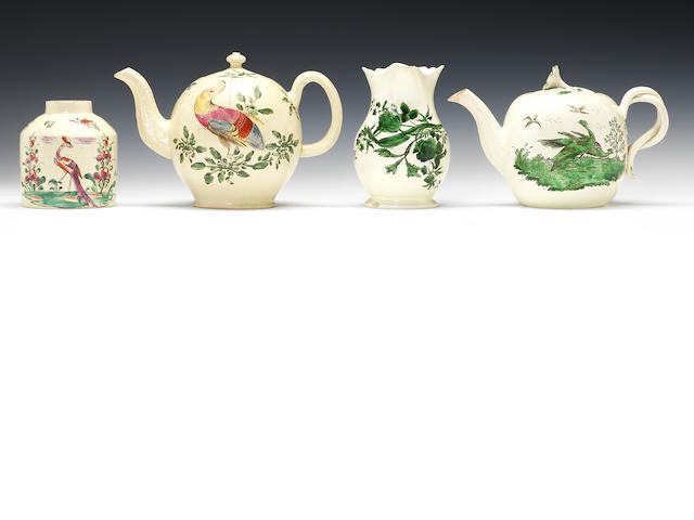 Two teapots and covers, two jugs and a tea canister