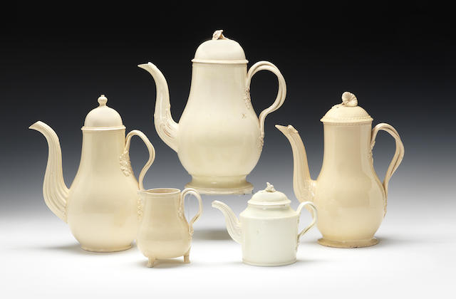 Three coffee pots and covers, a tea pot and cover and a jug