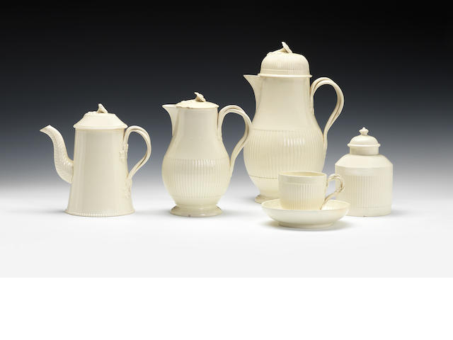 A reeded part coffee set, a conical coffee pot and cover and creamware sucrier and cover