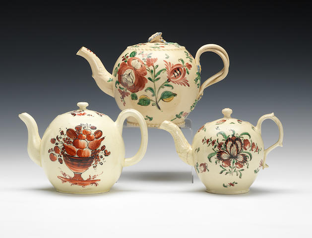 Three ceamware teapots and covers