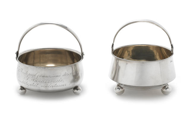 Two Russian silver swing handled baskets, silver mounted German flask, (glass damaged) and a plated pot and cover