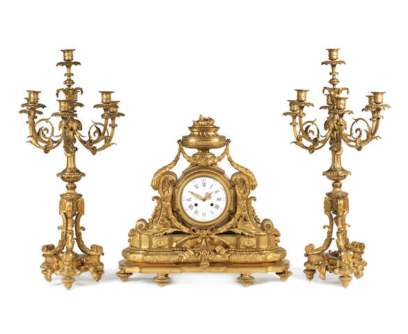Three piece clock garniture in gilt-bronze by Marquis