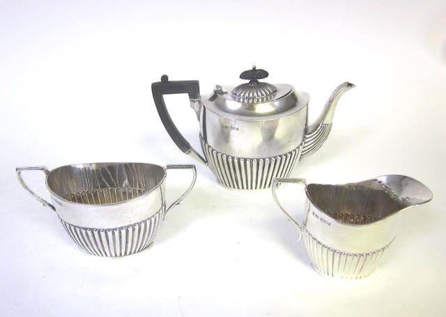 A late Victorian/early Edward VII silver matched three piece tea service by Joseph Rodgers & Sons, Sheffield 1900-1902  (3)