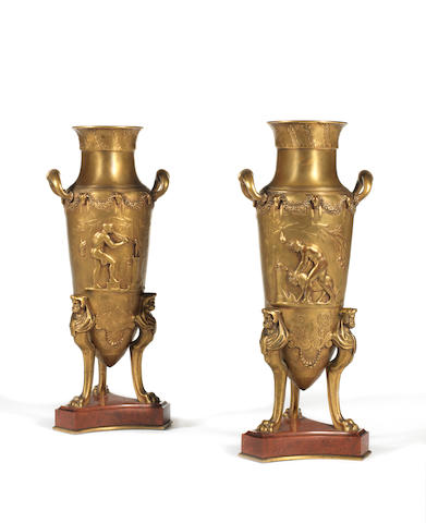 A pair of French late 19th century Neo-Grec gilt bronze and marble urnsby Barbedienne after a design by F. Levillain, Paris