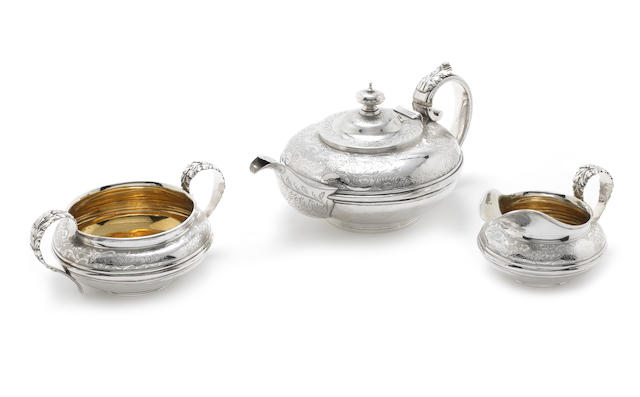A matched George IV silver three-piece tea service, the sugar and cream by Charles Fox, the teapot possibly by John Wakefield, London 1827-28