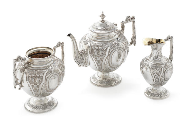 An Edwardian silver three-piece tea service by Walker & Hall, Sheffield 1903