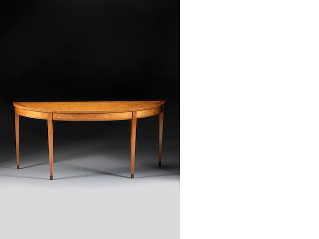 A George III satinwood and tulipwood banded semi-elliptical side table