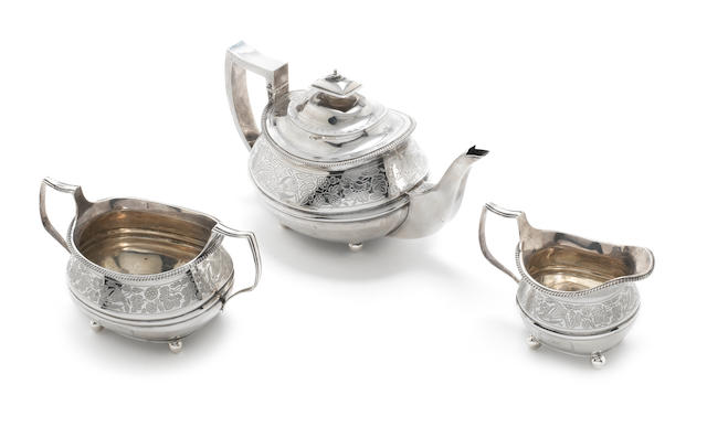 A matched George III/William IV  silver  three-piece tea service by Thomas Wallis, London 1811, the teapot by Samuel Hayne & Dudley Cater, London 1836  (3)