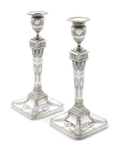 A pair of 18th century style silver  candlesticks by James Deakin & Sons, Sheffield 1914  (2)