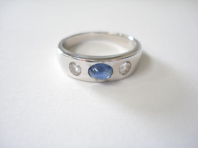 A cabochon sapphire and diamond band ring