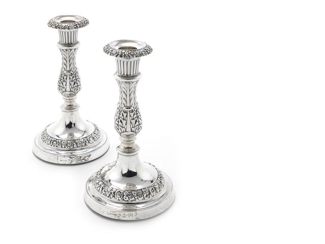 A pair of George III silver candlesticks by John & Thomas Settle, Sheffield 1818  (2)