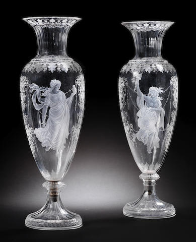 A pair of engraved vases with classical maidens