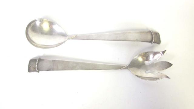 A pair of metalware salad servers incuse mark ROYAL HICKMAN and three crowns  (2)