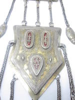 An Estern solver and enamel triple pendant