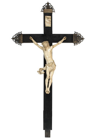 An Italian early 18th century carved ivory Corpus Christi on an ebony cross