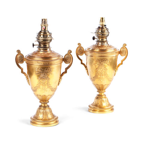 A pair of Victorian gilt-metal two-handled urn-shaped oil lamps