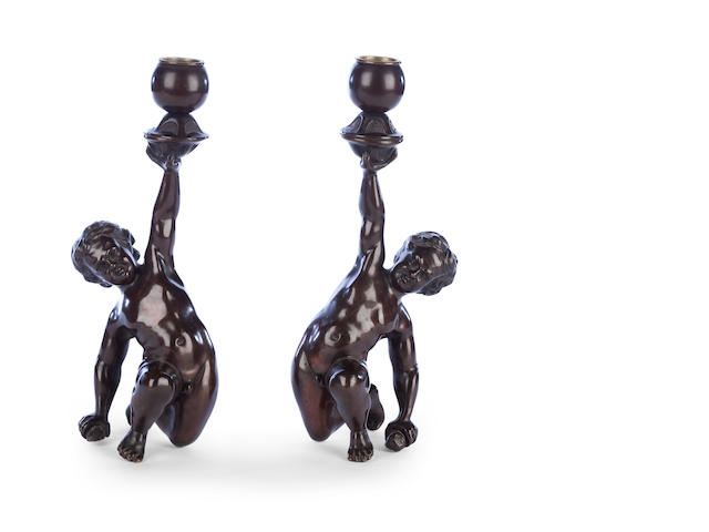 A pair of bronze candlesticks