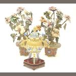A silver gilt and cloisonné censer and cover and a pair of flowering plant ornaments,