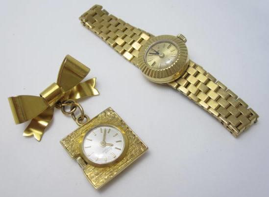 A lady's wristwatch, by Tudor and a fob watch, by Girard Perregaux