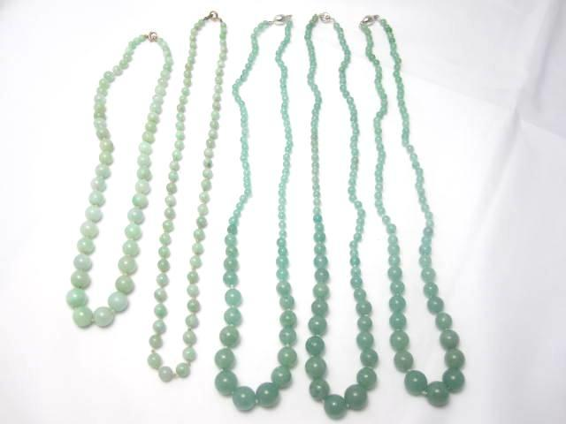 A collection of jadeite and moss agate bead necklaces
