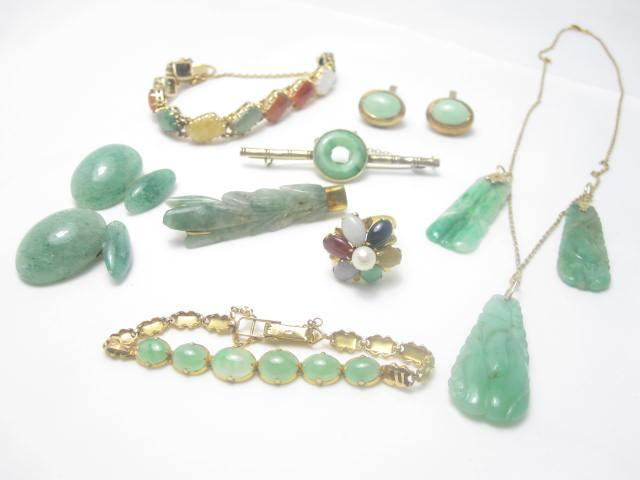 A collection of jadeite and moss agate jewellery
