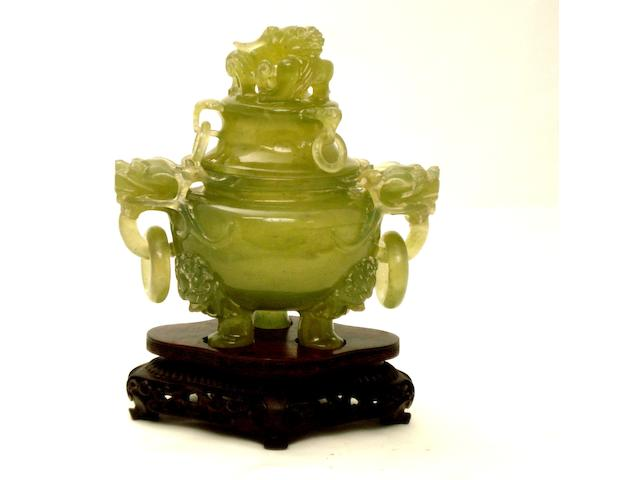 A green hardstone tripod censer and cover 20th century
