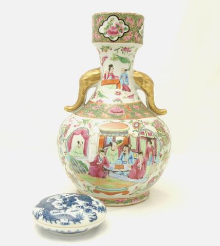 A Canton export famille rose vase and a blue and white seal paste pot and cover