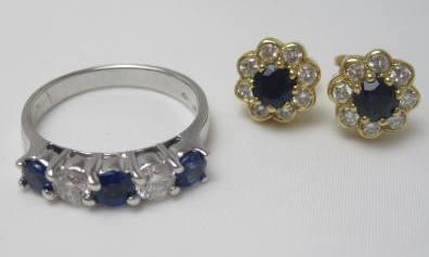 A sapphire and diamond ring and earrings
