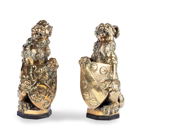 A pair of early Victorian cast brass fire dogs