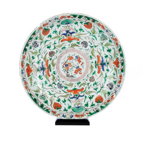 A famille verte saucer dish Bearing a Kangxi ruyi head mark,