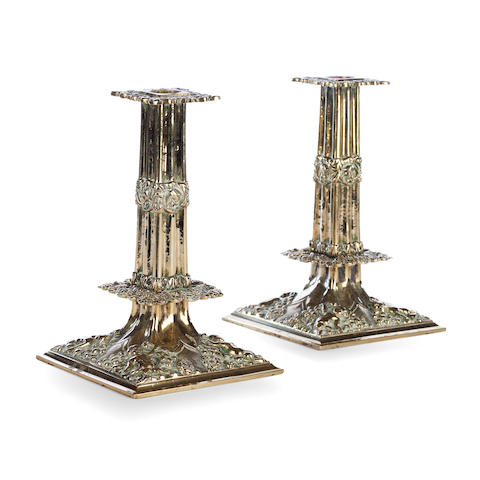 A pair of brass candlesticks of 17th century style