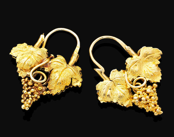 A pair of antique gold earrings